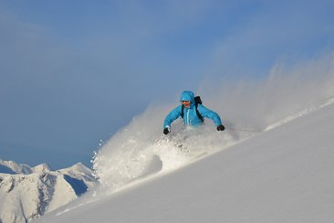 Ski touring with powder-snow and sunshine