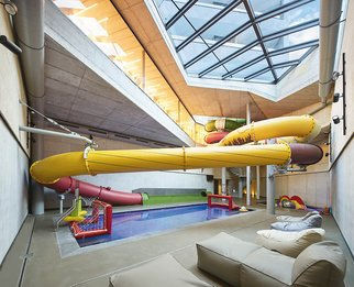 Children's pool and huge water slide over multiple floors