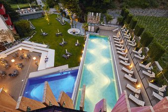 Garden of the hotel Lindenhof with a wellness pool and a sports pool