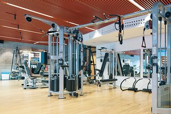 Gym with workout equipment from Technogym